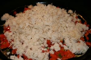 Add the crab meat and heat through.
