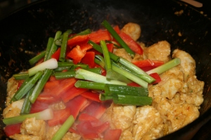 In a cast iron skillet, brown the chicken pieces. Add the vegetables.